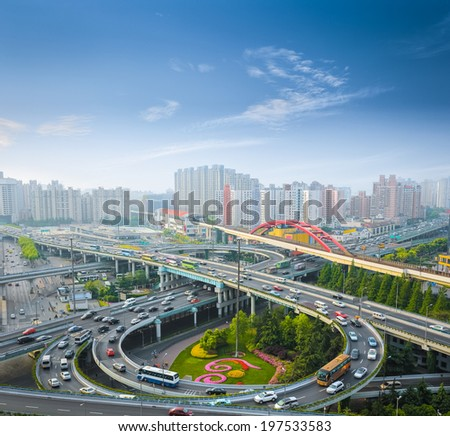 city overpass in the early morning rush hour ,shanghai ,China  - stock photo