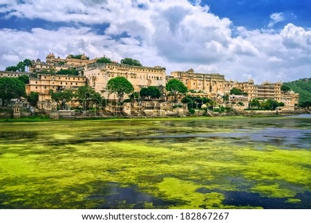 City Palace in Udaipur, India, view over Pichola lake - stock photo