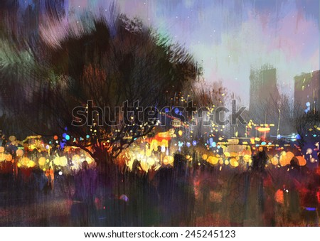 city park with crowd of people at night  - stock photo