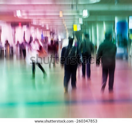 City pedestrians walking street during rush hour in urban business area  - stock photo