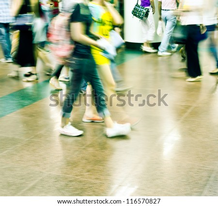 city people rushing in a station of the metro abstract background blur action - stock photo