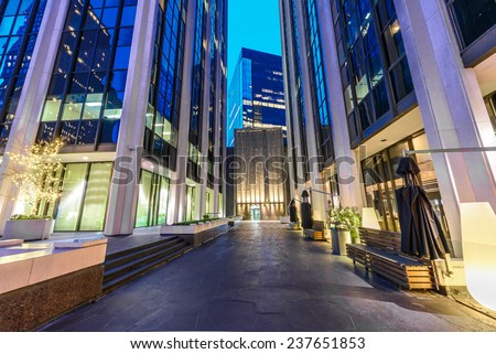 City plaza at night. Night scene of modern colorful city life with skyscrapers, highrise buildings. Vancouver downtown  at night. - stock photo