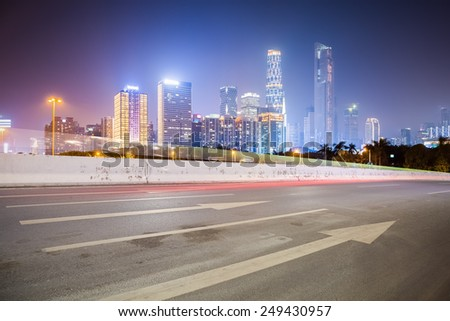 city road with modern buildings background in guangzhou at night - stock photo