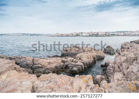 city rock sea blue sky - stock photo