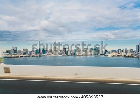 city scape of japan - Modern city, skyscrapers, and bay on highway view (bus window)  - stock photo