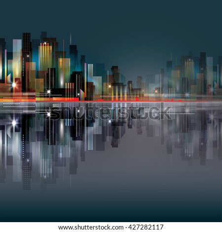 City scene at night with waterfront - stock photo
