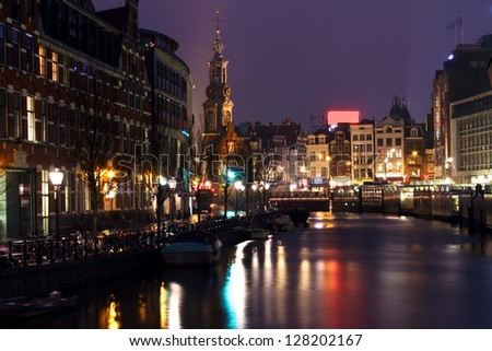 City scenic from Amsterdam with the Munttower at night in the Netherlands - stock photo