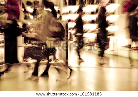 city shopping people crowd at marketplace shoe shop blur motion - stock photo
