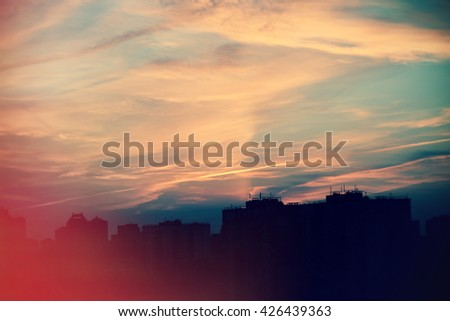 city silhouette against cloudy sky - stock photo
