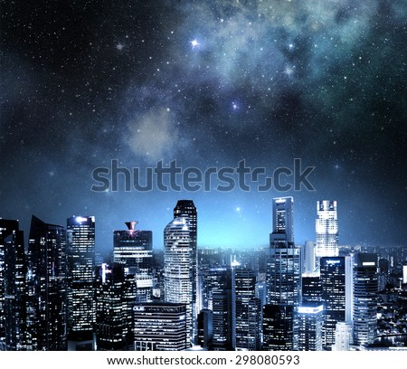 city skyline at night under a starry sky - stock photo