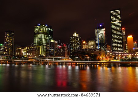 city skyline of Brisbane central business district from the south bank of Brisbane river at night - stock photo