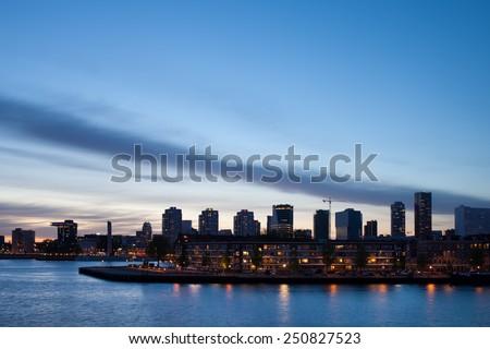 City skyline of Rotterdam in the evening, Holland, Netherlands. - stock photo