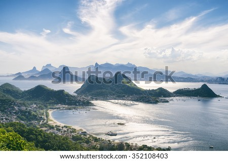 City skyline scenic overlook of Rio de Janeiro, Brazil with Niteroi, Guanabara Bay, and Sugarloaf Mountain - stock photo