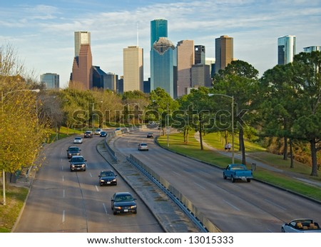 City Skyline with traffic rushing to and from downtown - stock photo