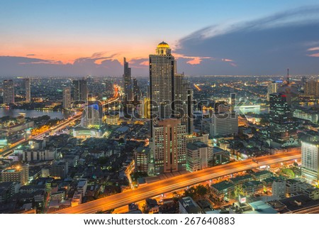 City skyline with urban skyscrapers at sunset. - stock photo