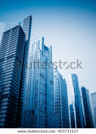 city skyscrapers,blue toned image. - stock photo