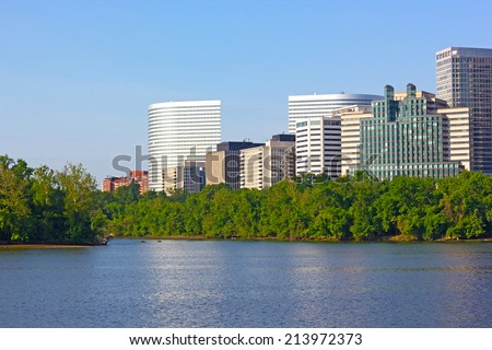City skyscrapers on Virginia side of Potomac River. View on office buildings from Georgetown Park, Washington DC. - stock photo