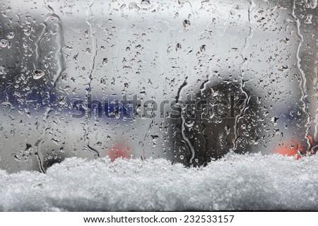 city snowfall motion cars - stock photo
