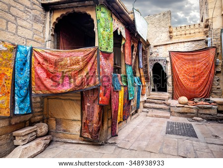 City street market with shops of Jaisalmer fort in Rajasthan, India - stock photo