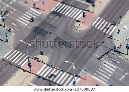 City street traffic and pedestrian crossing -  aerial view - stock photo