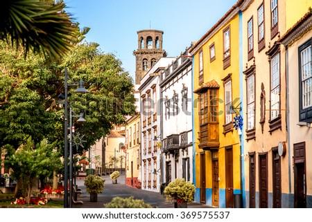 City street view with church tower in La Laguna town on Tenerife island - stock photo