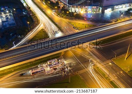 City traffic at crossroads at night - stock photo