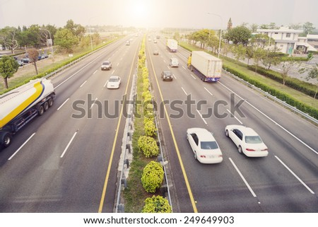 City transport - cars traveling on highway in daytime  - stock photo