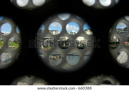 city view through wall - stock photo