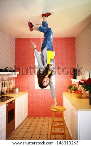 City young china new house wife is in a trouble kitchen world, like zero gravity rotating in housekeeping and food cooking - stock photo