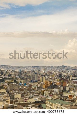 Cityscape aerial view of Quito city from the top of San Juan Basilica church. - stock photo