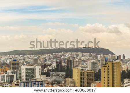Cityscape aerial view of Quito from the top of San Juan Basilica church. - stock photo