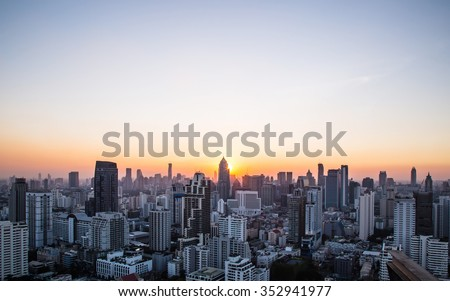 Cityscape and sunset at evening time - stock photo