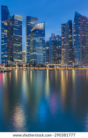 Cityscape at Marina Bay Business District  twilight with water reflection- Singapore - stock photo