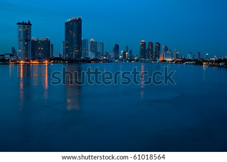 Cityscape bangkok high rise building reflection in the river - stock photo