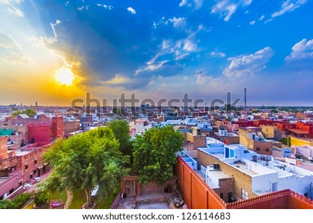 cityscape of Bikaner, old indian City in Rajasthan with a famous fort in sunset - stock photo