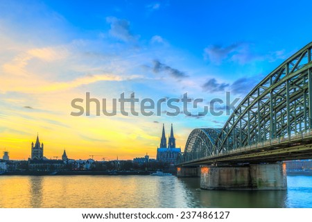 Cityscape of Cologne from the Rhine river at sunset - stock photo