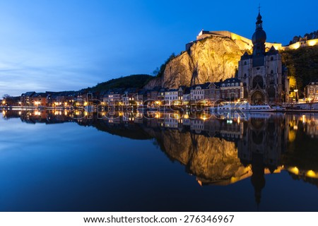 Cityscape of Dinant at night along the river Meuse, Belgium - stock photo