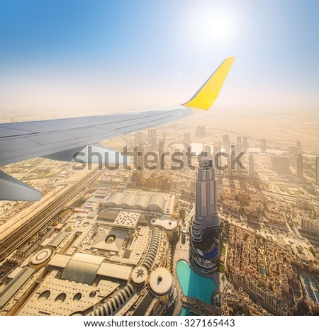 Cityscape of Dubai from aeroplane window, bird view, UAE - stock photo