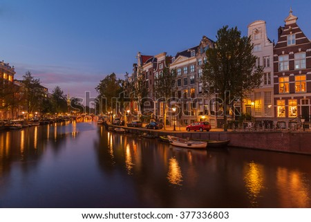 Cityscape of dutch canal at twilight - stock photo