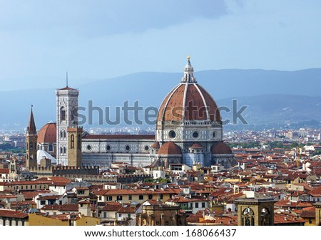Cityscape of Florence Italy showing the homes, the cathedral and the bell tower - stock photo