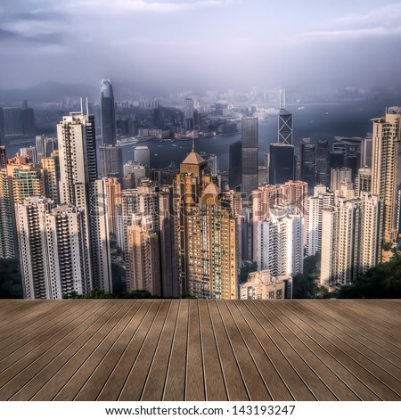 Cityscape of Hong Kong skyscrapers and skyline with wooden ground. - stock photo