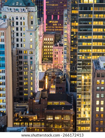 Cityscape of lit building at night from New York City - stock photo
