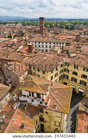 Cityscape of Lucca with Guinigi tower in front, Tuscany, Italy - stock photo