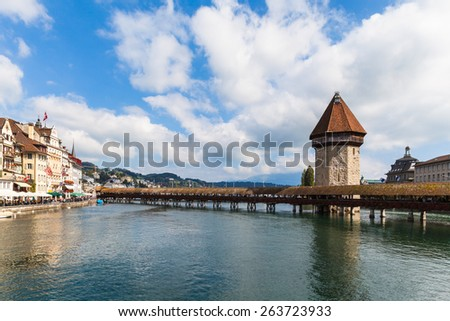 Cityscape of Lucerne old town with the famous chapel bridge and Reuss river - stock photo