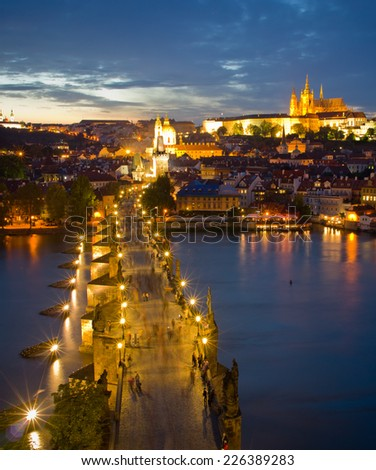 Cityscape of Prague with Castle and Charles Bridge at night, Czech Republic  - stock photo