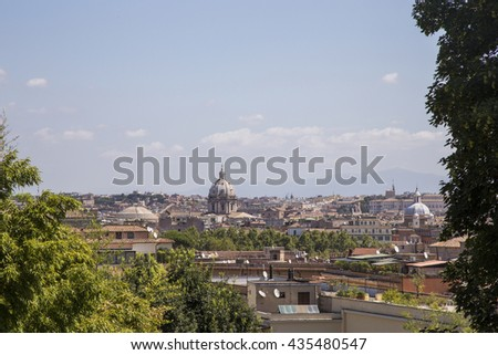Cityscape of Rome Italy in sunlight with Saint Peter Basilica in the background - stock photo