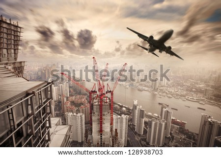 cityscape of shanghai with flight - stock photo
