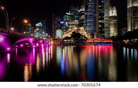 Cityscape of Singapore at night, colorful bridge - stock photo