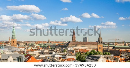 Cityscape of the old part of the city with bridge (Church of Our Saviour, Sankt Nikolaj Kirke) from the observation deck at the Round tower (Rundetaarn) in Copenhagen, Denmark - stock photo