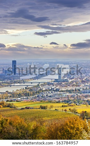 Cityscape of Vienna and Danube in the autumn at dusk. At the Right the so called Millenium Tower, at the left the Danube City with its new DC Tower. Also visible Airport Vienna and Tower in the back. - stock photo